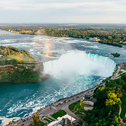 From Niagara Falls to Chicago, follow coastlines and visit vibrant cities.